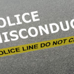 Police misconduct caption behind yellow tape for police line do not cross