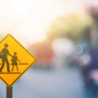 School zone traffic sign with blurred background