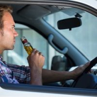 Guy drinking alcohol while driving