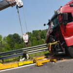 Crane pulling the remains of fatal truck accident