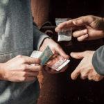 two men dealing narcotics