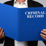 criminal record blue file being read by businesswoman