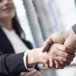 Businesspeople handshake close up view