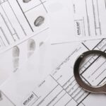 Handcuffs and fingerprint record sheets, top view. Criminal investigation