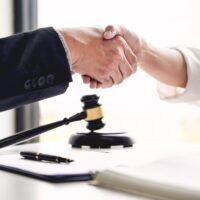 Handshake after cooperation between attorneys lawyer and clients discussing a contract agreement hope of victory over legal fighters, Concepts of law, advice.