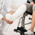 Doctor Examining Leg Of Patient